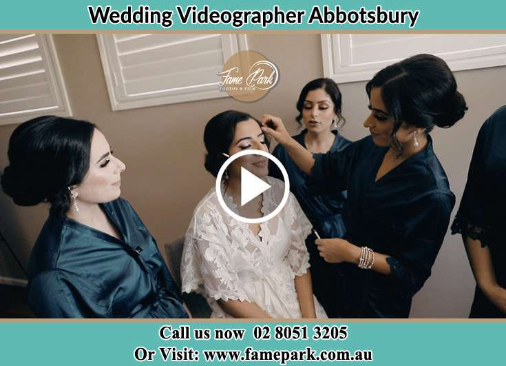 Bride getting her make up done with her secondary sponsors Abbotsbury NSW 2176
