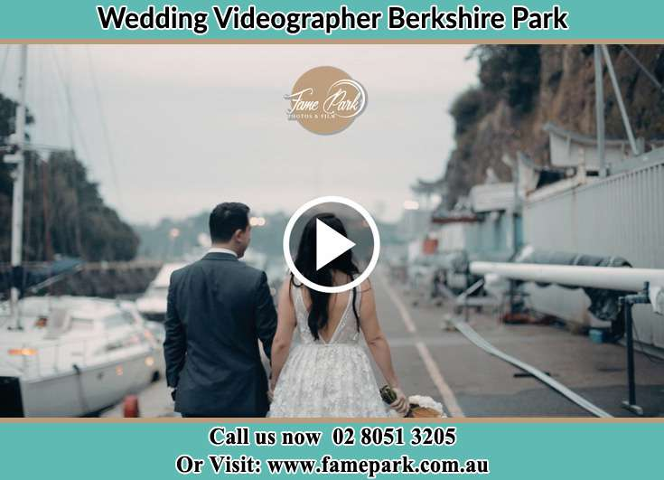Bride and Groom hold hands while walking at the harbor Berkshire Park NSW 2765