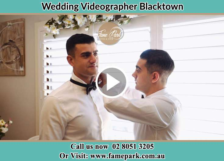 Groom bow tie being fixed by his best man Blacktown NSW 2148