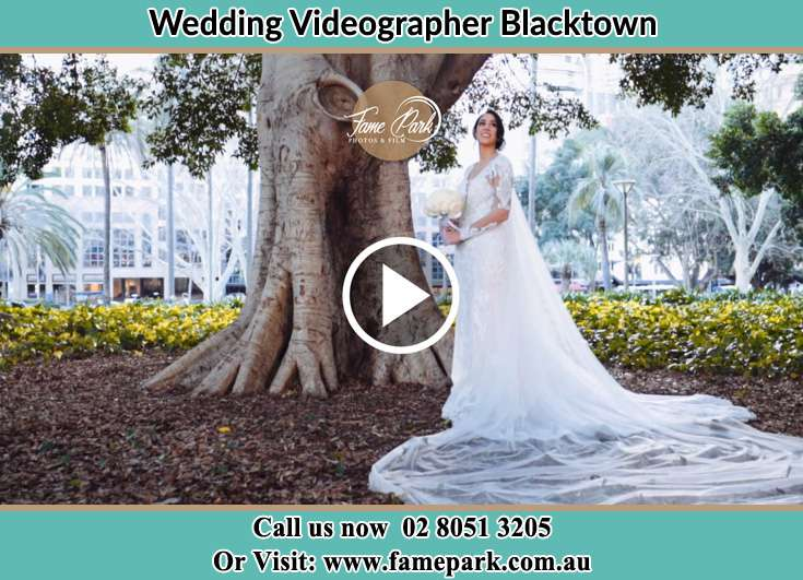 Bride holding a bouquet of flowers under the tree Blacktown NSW 2148