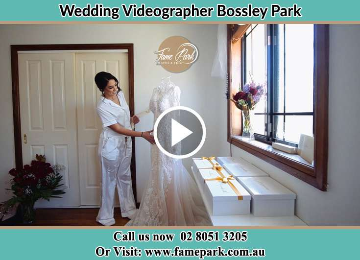 Bride looking at her wedding dress Bossley Park NSW 2176