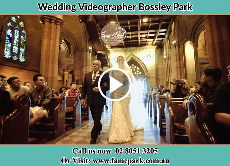 Bride and her father walking at the aisle Bossley Park NSW 2176