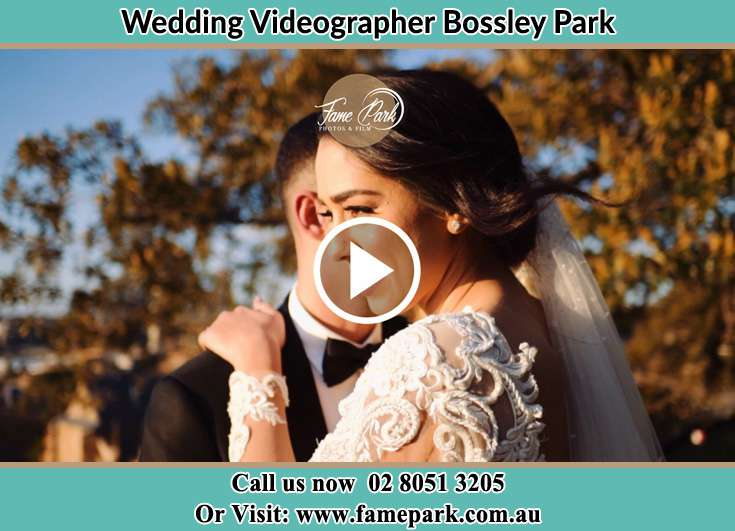 Bride and Groom hold each other in the park Bossley Park NSW 2176