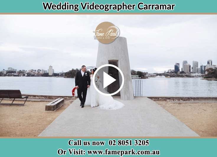 Bride and Groom hold hands at the bay Carramar NSW 2163