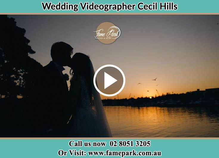Bride and Groom kissed at the lake shore Cecil Hills NSW 2171
