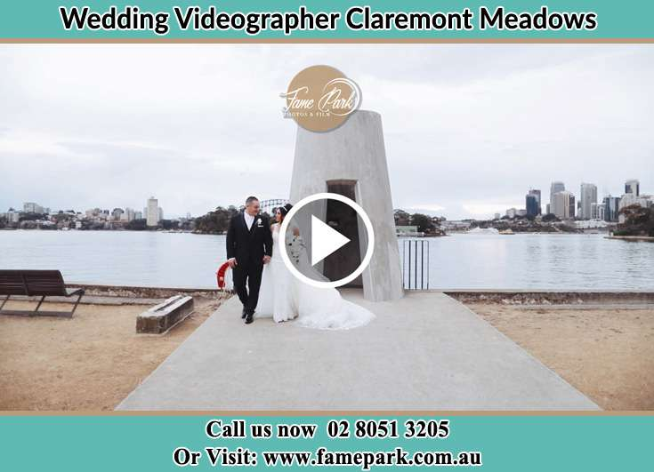 Bride and Groom walk near the shore crowds Claremont Meadows NSW 2747