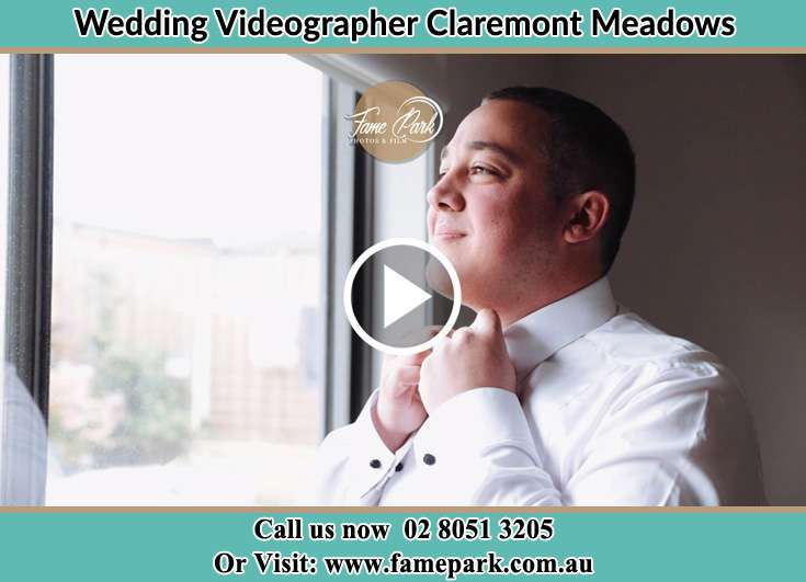 Groom getting ready while looking at the window Claremont Meadows NSW 2747