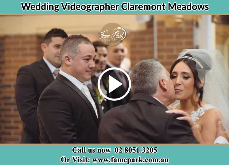Bride and her father kissed her during the ceremony Claremont Meadows NSW 2747