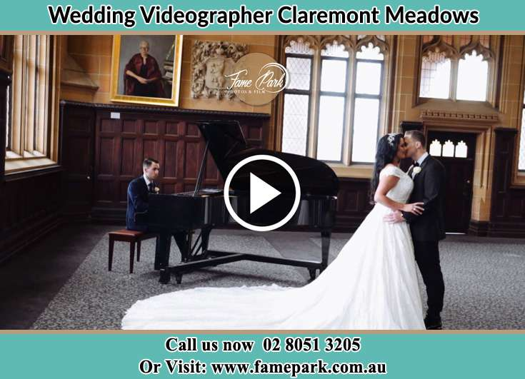 Bride and Groom kissed near the pianist Claremont Meadows NSW 2747