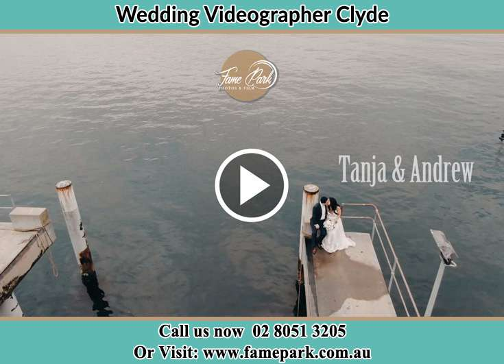 Bride and Groom kissed while sitting at the bay walk Clyde NSW 2142