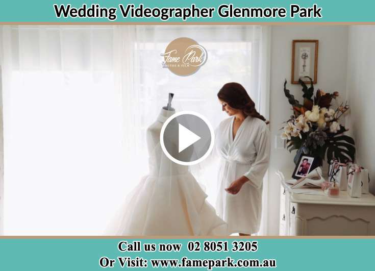 Bride looking at her wedding dress Glenmore Park NSW 2745
