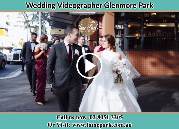Bride and Groom looking at each other while walking Glenmore Park NSW 2745
