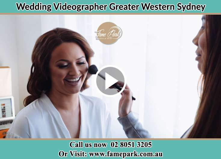 Bride getting ready and the stylist putting her make up Greater Western Sydney