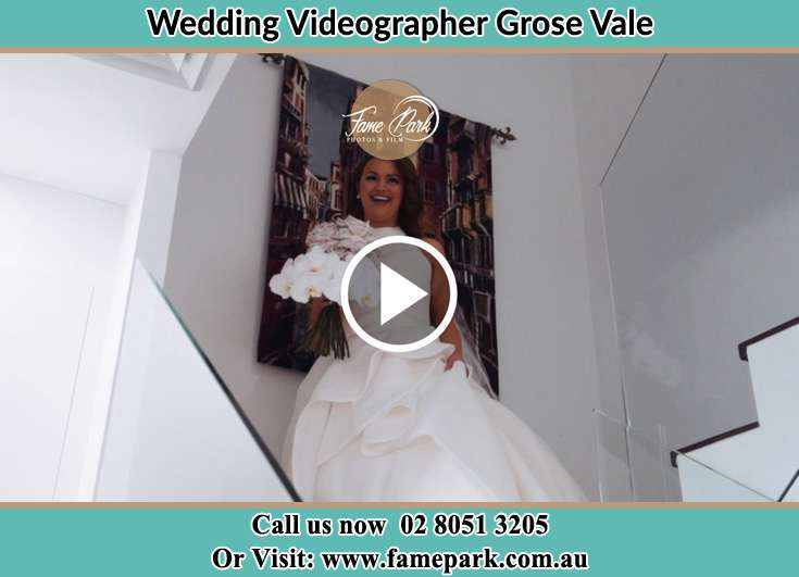 Bride walking down the staircase Grose Vale NSW 2753