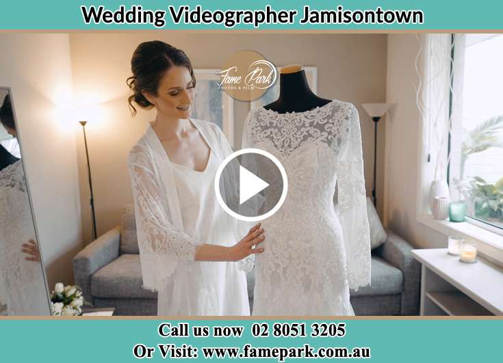 Bride looking at her wedding gown Jamisontown NSW 2750