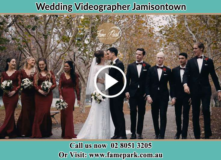 Bride and Groom kissed at the park with thier secondary sponsors Jamisontown NSW 2750