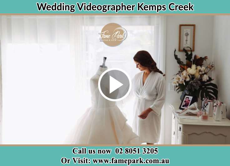 Bride looking at her dress Kemps Creek NSW 2178