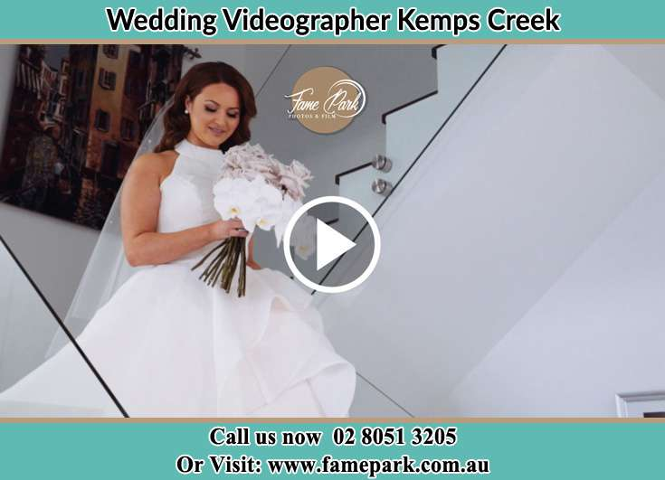 Bride walking down the staircase Kemps Creek NSW 2178