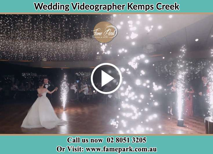 Bride and Groom looking at each other while dancing Kemps Creek NSW 2178