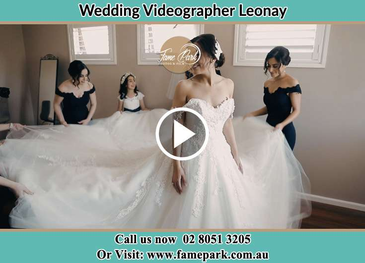Bride and her secondary sponsors arranged her wedding gown Leonay NSW 2750