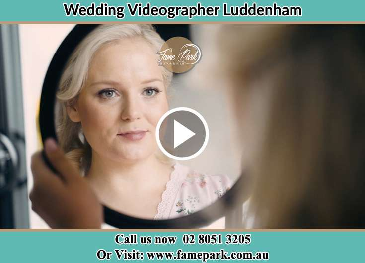 Bride looking at the mirror Luddenham NSW 2745