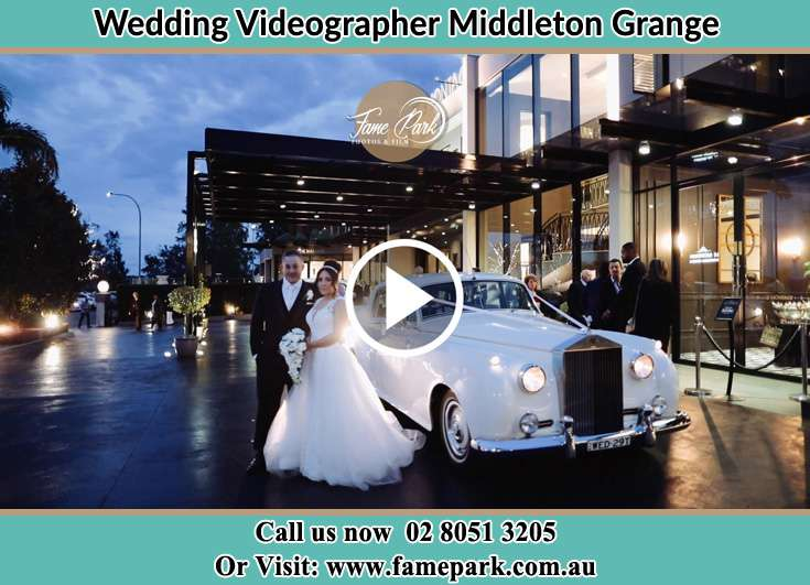 Bride and Groom near their bridal car Middleton Grange NSW 2171