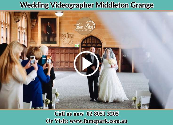 Bride and her father walking in the aisle Middleton Grange NSW 2171