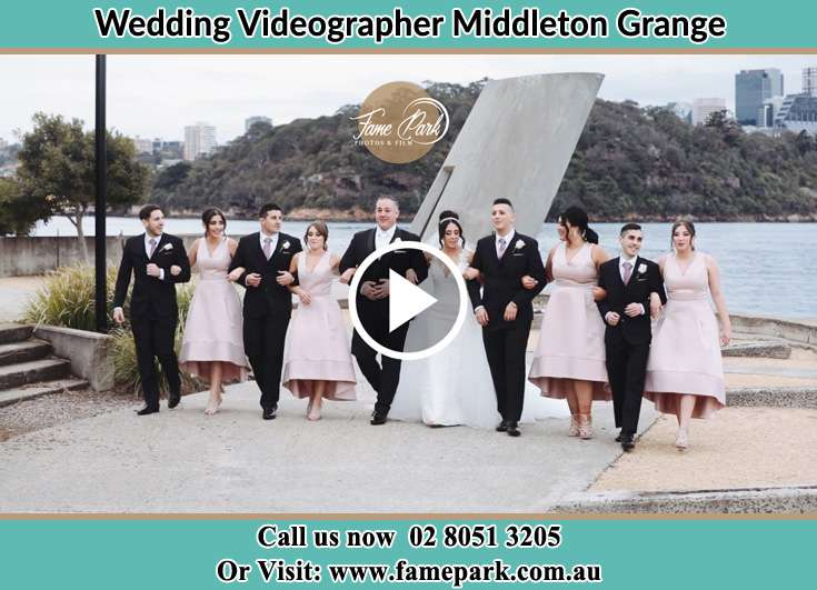 Bride and Groom with their secondary sponsors near the shore Middleton Grange NSW 2171