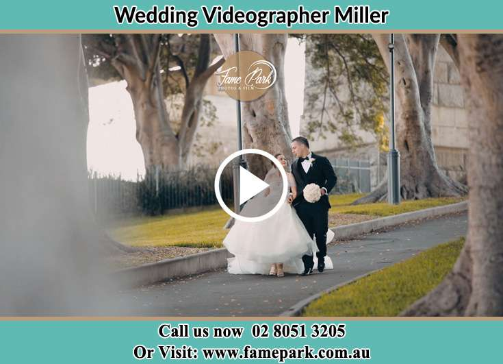 Bride and Groom looking at each other while walking in the park Miller NSW 2168