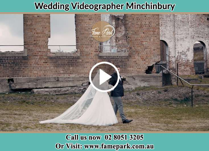 Bride and Groom walking at the ruin Minchinbury NSW 2770
