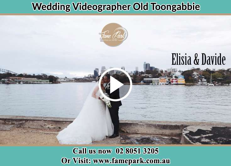 The newlyweds kissing near the shore Old Toongabbie 2146
