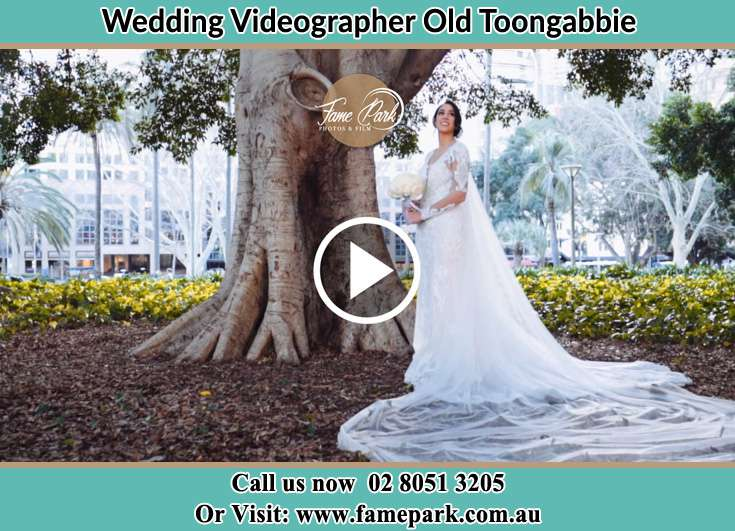 The Bride holding a bouquet of flowers near the tree Old Toongabbie 2146
