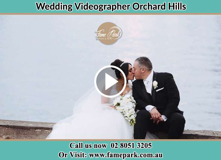 The new couple kissing near the shore Orchard Hills NSW 2748