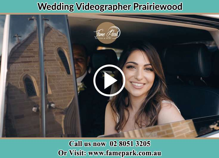 The Bride smiling for the camera inside the wedding car Prairiewood NSW 2176