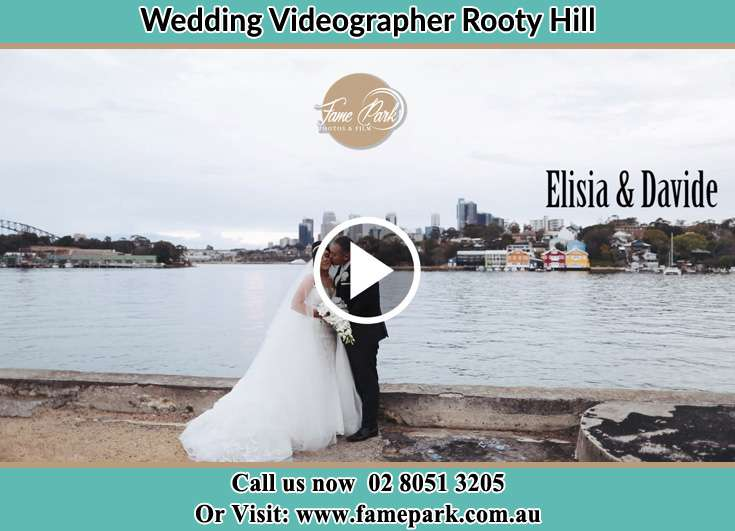 The newlyweds kissing near the shore Rooty Hill NSW 2766
