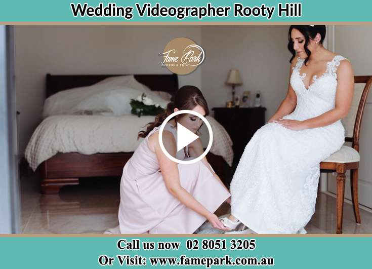 A bridesmaid putting a shoe onto the Bride's foot Rooty Hill NSW 2766