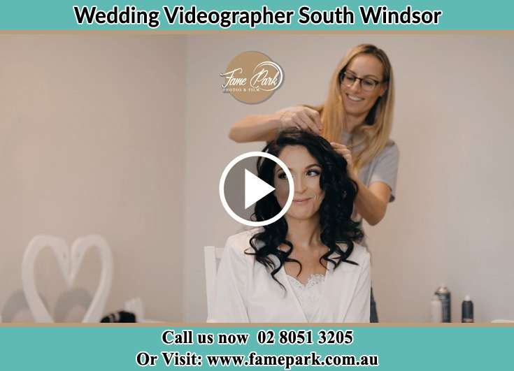 The hairdresser fixing the hair of the Bride South Windsor NSW 2756