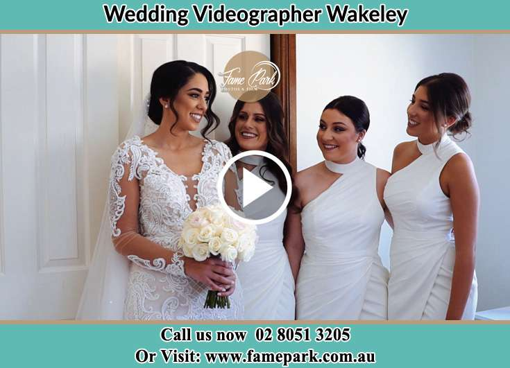 The Bride and her bridesmaids smiling at each other Wakeley NSW 2176